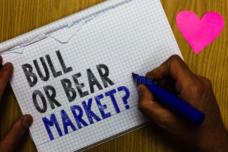 手写文本公牛或熊市问题 概念意思询问某人关于多行他的营销方法纸的记数器 库存图片