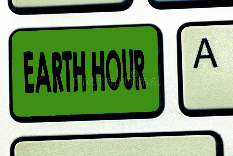 手写文本地球小时 意味全球性运动的概念呼吁对气候变化的更加巨大的行动 免版税库存照片