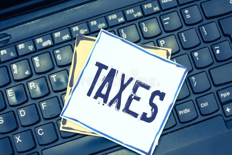 手写文本文字税 概念陈述收支的意思贡献征收由工作者收入的政府 免版税库存图片