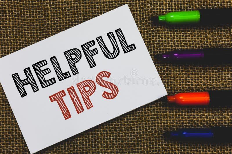 手写文本有用的技巧s是 概念意思要求专家的解答咨询白色警报纸的提示 免版税库存照片