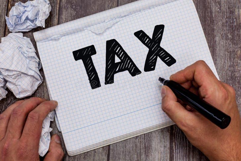 手写文本税 意味强制的贡献的概念陈述收支征收由政府强加 图库摄影