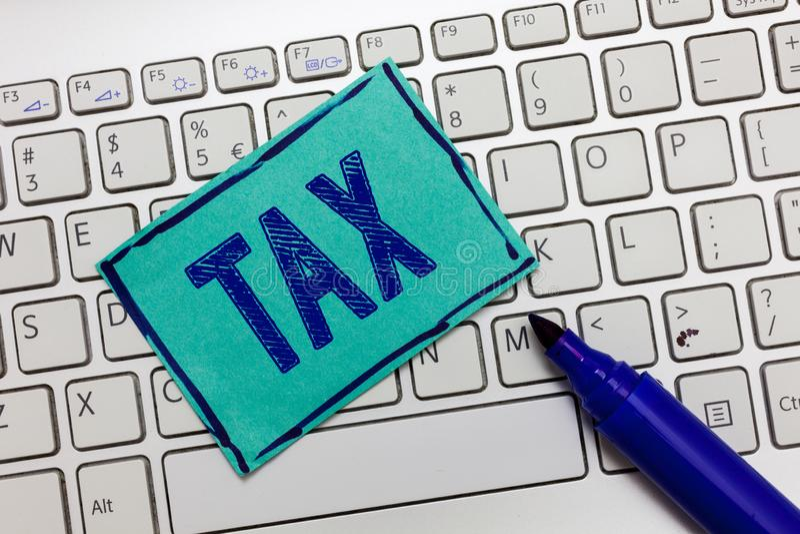 手写文本税 意味强制的贡献的概念陈述收支征收由政府强加 免版税库存图片