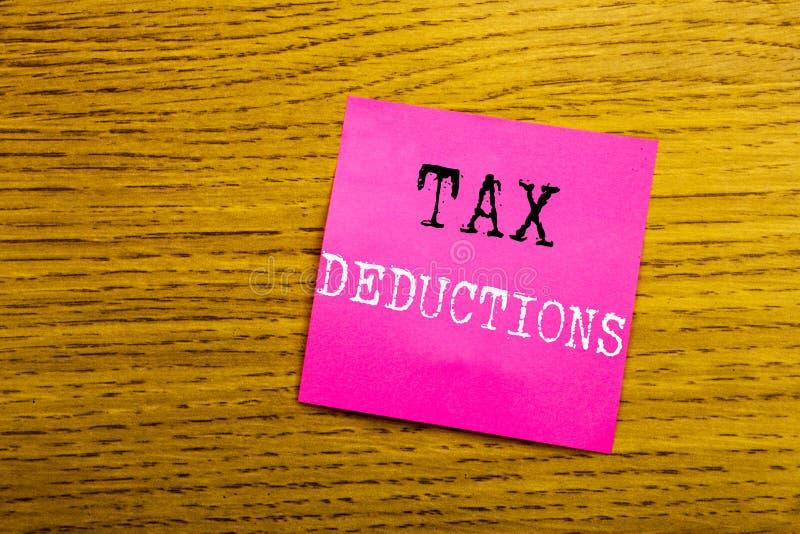 手写显示税收减免的公告文本 在稠粘写的财务接踵而来的税钱扣除的企业概念 图库摄影