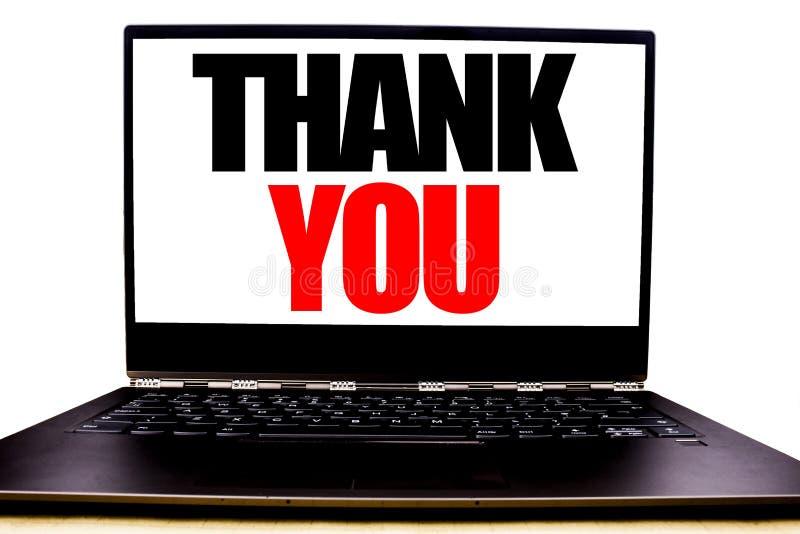 手写的文本陈列感谢您 企业在显示器前面屏幕写的谢意感谢的概念文字,白色backgroun 库存照片