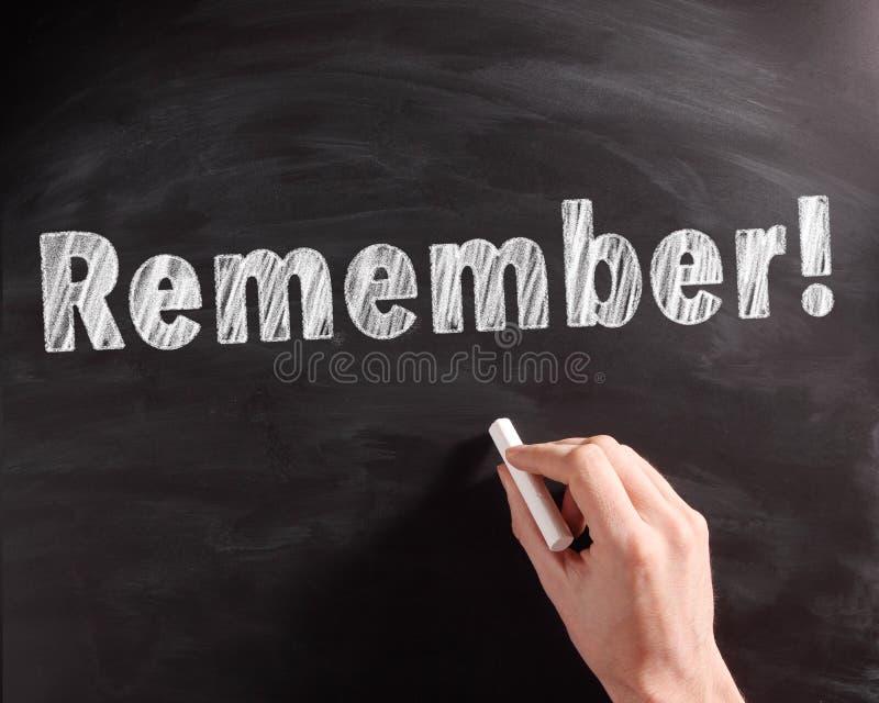 手写记住在黑黑板的文本 免版税库存照片
