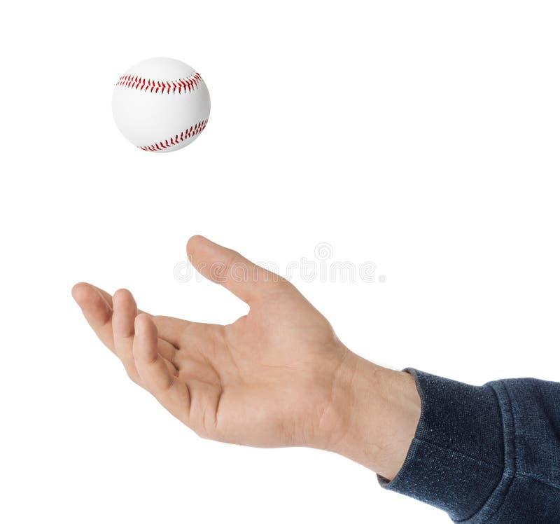 手和棒球球 库存照片