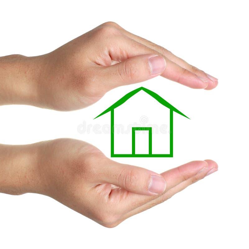 手和温室 免版税图库摄影