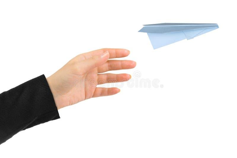手和飞行的金钱飞机 图库摄影