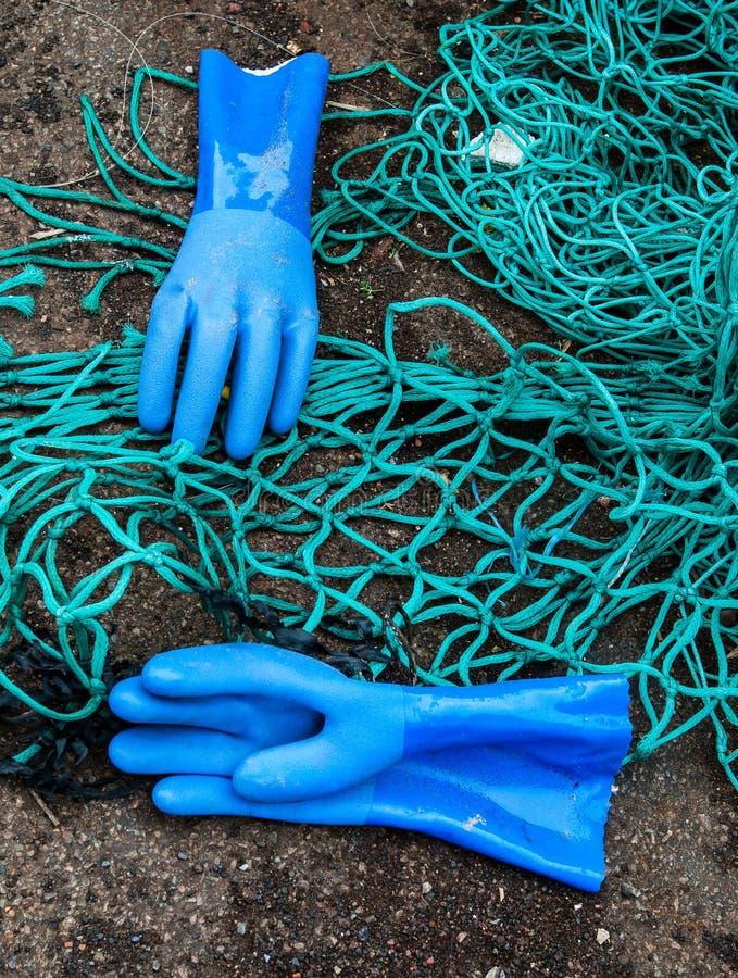 手套和网 免版税库存图片
