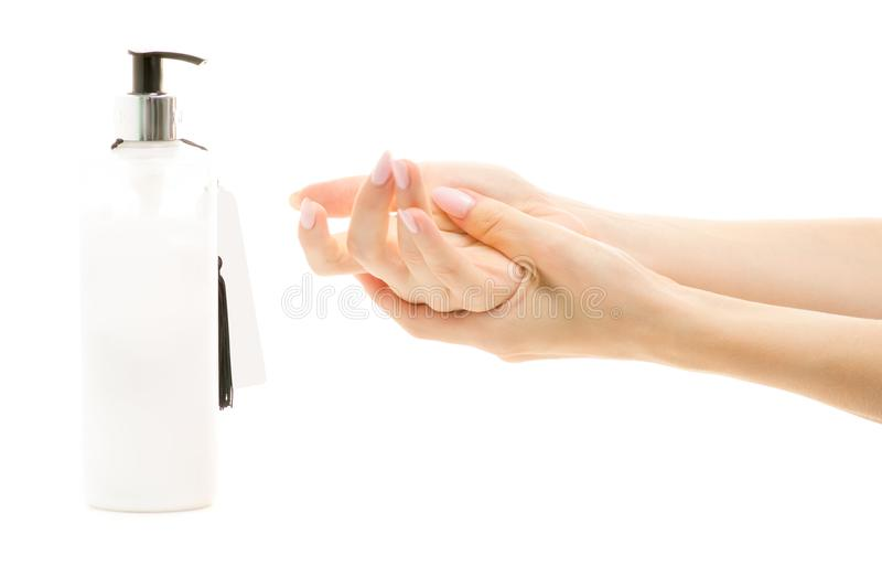 手奶油用分配器女性手 免版税库存图片
