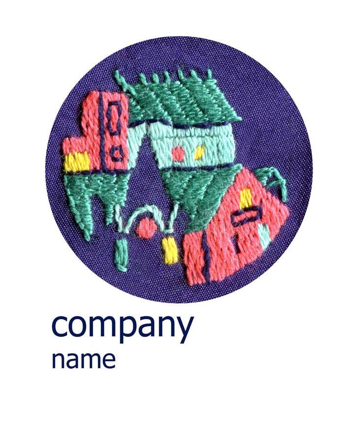 手工制造刺绣的,老镇商标 免版税库存图片