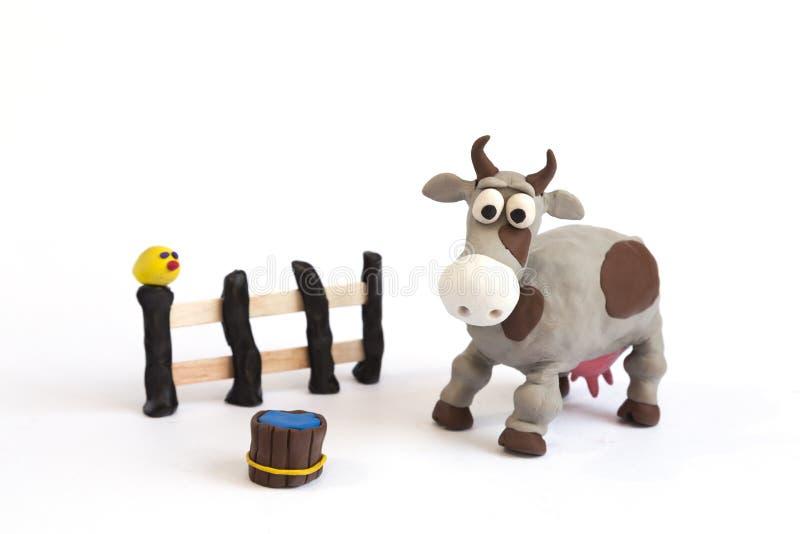 手工制造彩色塑泥黏土猪和母牛农场 库存图片