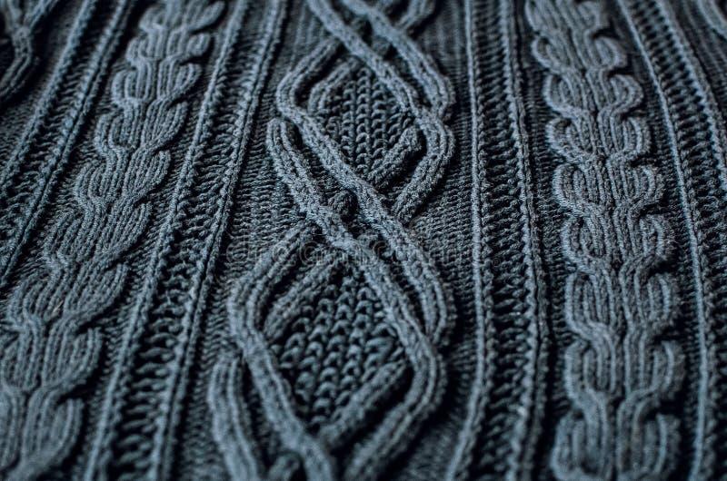 手工制造灰色编织的羊毛纹理背景 库存图片