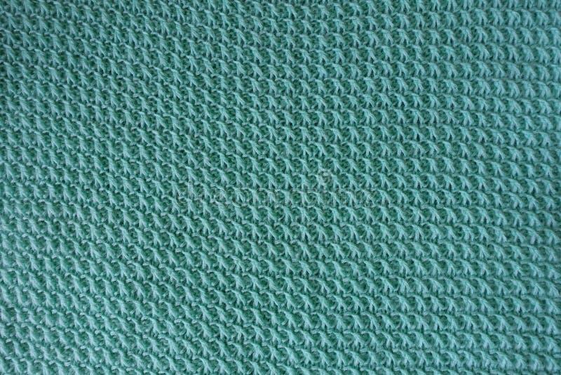 手工制造绿松石被编织的织品直接地从上面 免版税库存照片