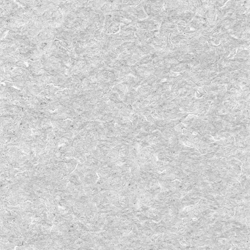 手工制造被漂白的无缝的纸,被击碎的纤维在背景中 免版税库存图片