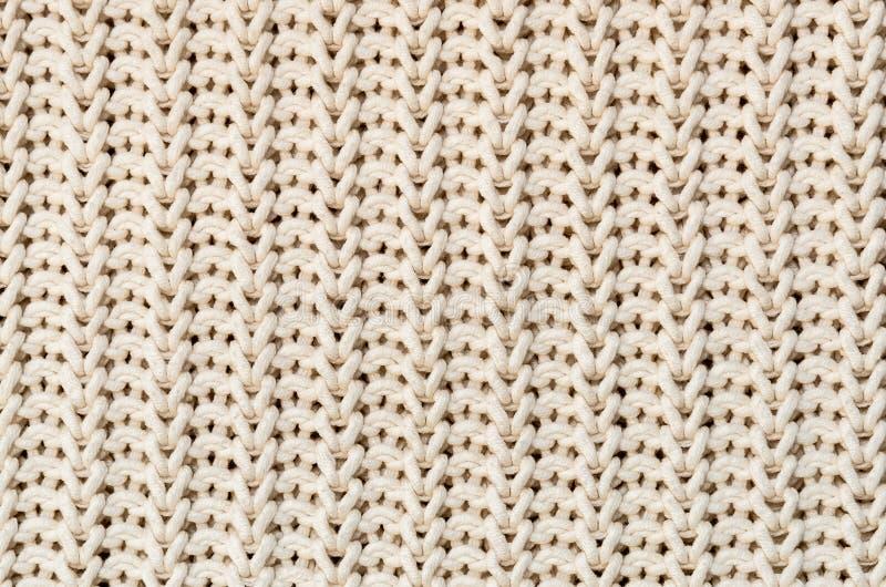 手工制造被编织的织品棉花白色奶油色颜色,布料背景被编织的纹理 免版税库存图片
