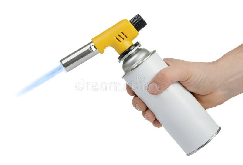 手工气体火炬燃烧器在手中在白色 库存照片