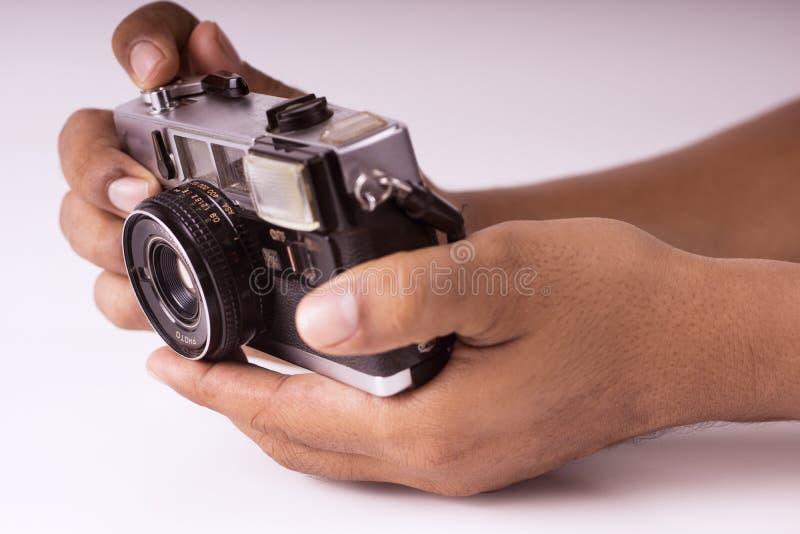 手扶的照相机 库存图片