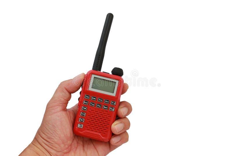 手扶红色的携带无线电话 免版税库存图片