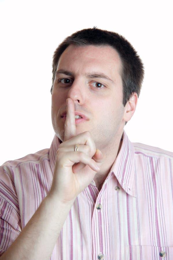 手指他的嘴唇人 免版税库存图片