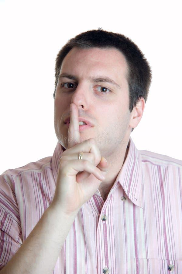 手指前面他的人嘴 免版税库存图片