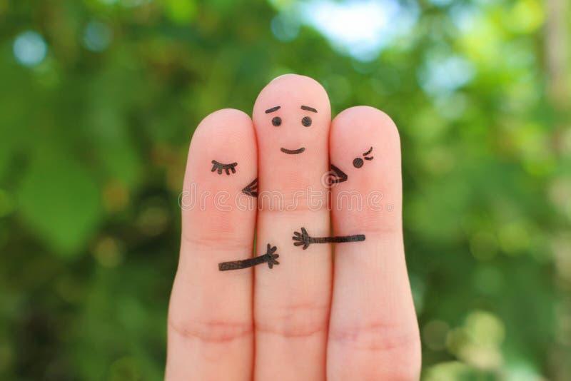 手指艺术 女孩的概念亲吻面颊的男孩 库存图片
