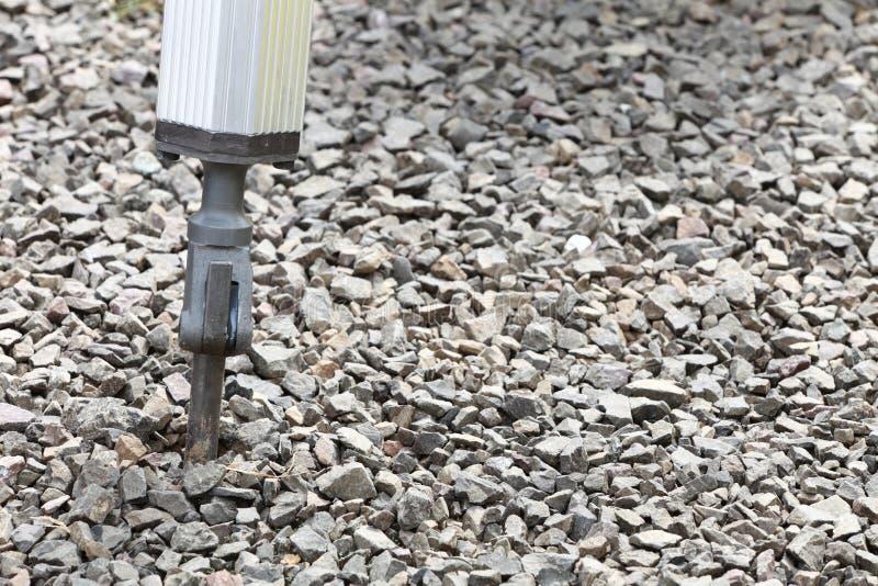 手提凿岩机气动排种式播种机的水力胳膊 库存照片