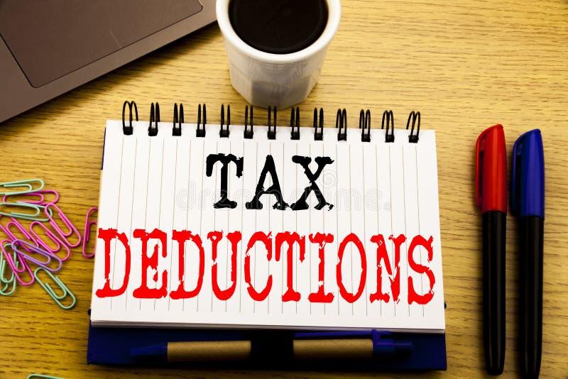 手文字显示税收减免的文本说明 在笔记本写的财务接踵而来的税钱扣除的企业概念bo 免版税库存图片