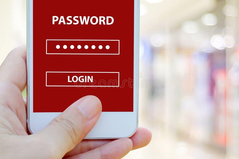 手有密码注册的藏品智能手机在迷离背景,网络安全的屏幕上 免版税库存图片