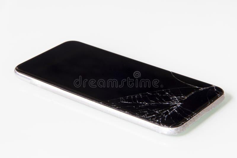 手机上需要维修的破裂液晶屏 库存照片