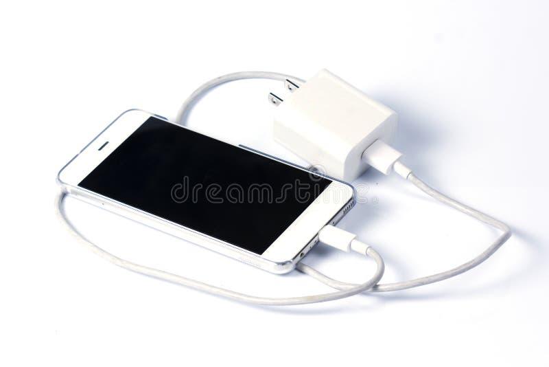 手机和充电器缆绳 免版税库存照片