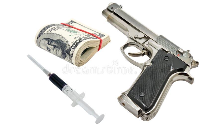 手枪、金钱和注射器 库存照片
