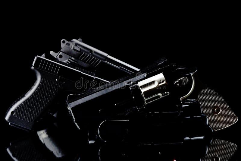 手枪和枪 免版税库存照片