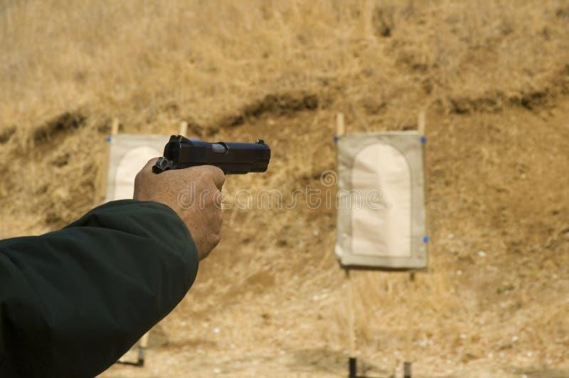 手枪射击者 库存图片