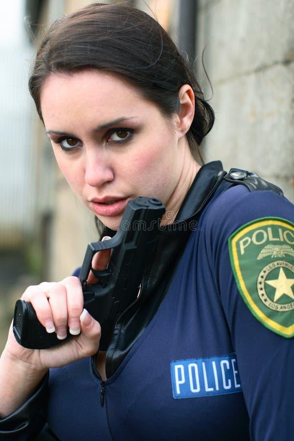 手枪警察妇女 免版税图库摄影
