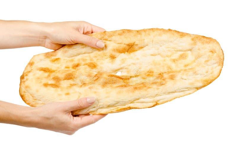 手用金黄皮塔面包,东部食物文化 免版税库存照片