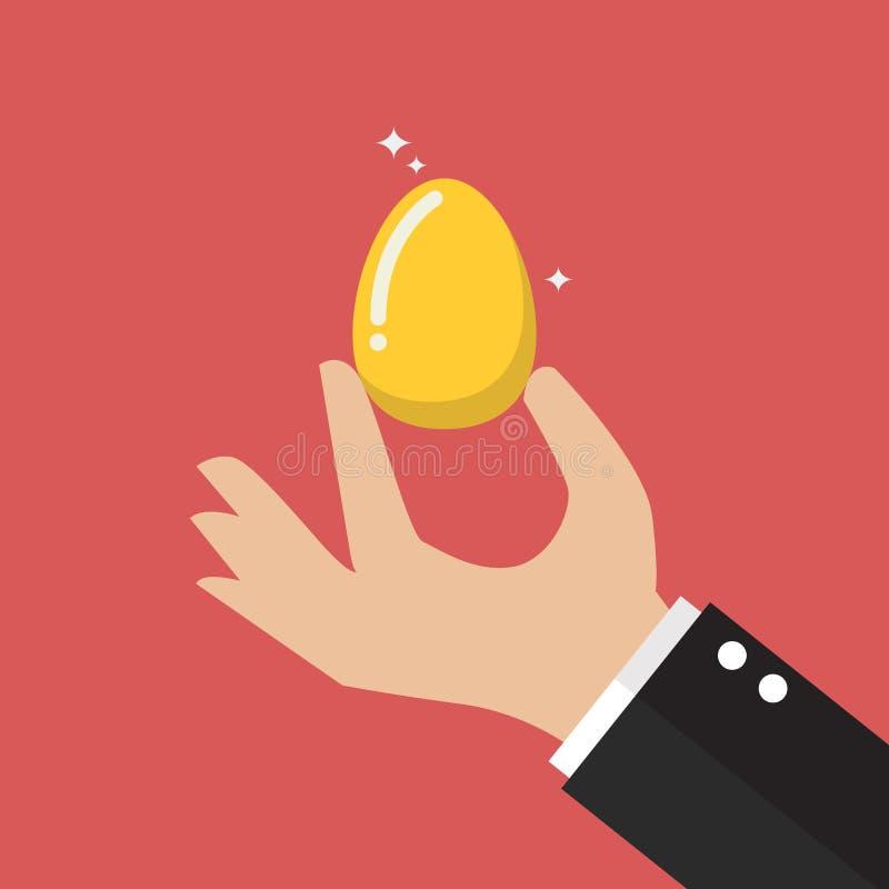 手用金黄鸡蛋 库存例证