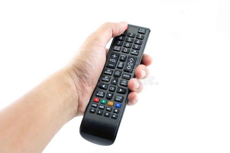 手紧迫在电视遥控的力量按钮 库存图片