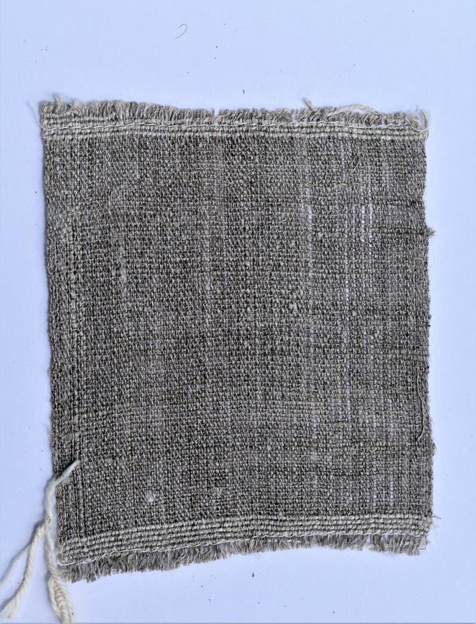 手织的手转动的亚麻布特写镜头  纺织品 库存图片