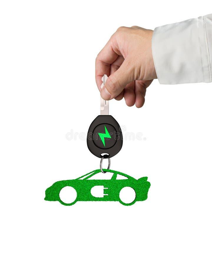 手给电车钥匙跑车绿色叶子钥匙圈 免版税库存图片
