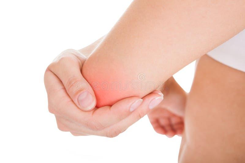 手肘痛苦妇女 免版税库存图片