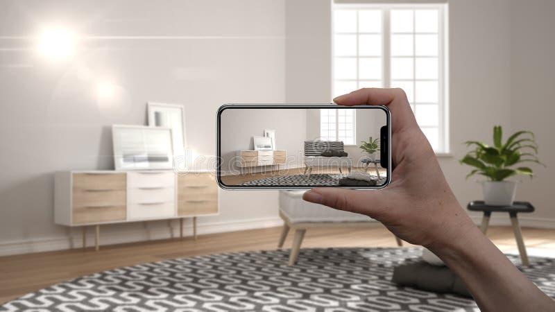 手藏品智能手机,AR应用,在真正的家,建筑师设计师概念模仿家具和室内设计产品 皇族释放例证