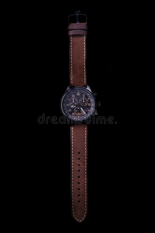 手表与棕色皮带的远征箭头 免版税库存照片