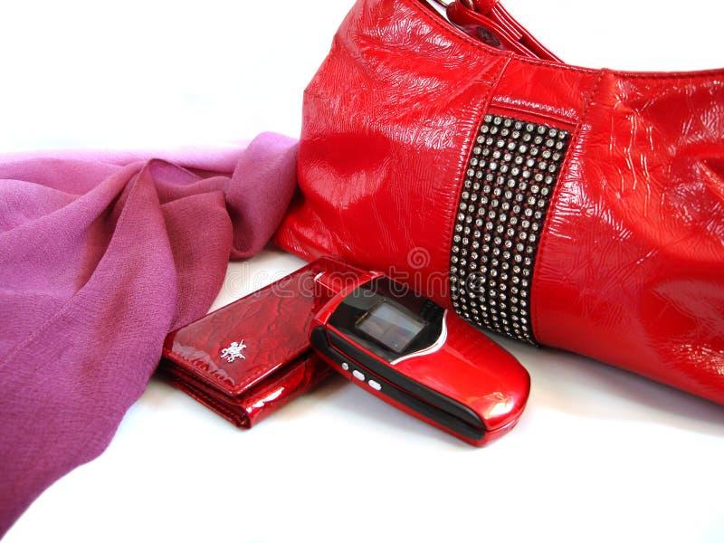 手袋移动电话红色钱包妇女 库存图片
