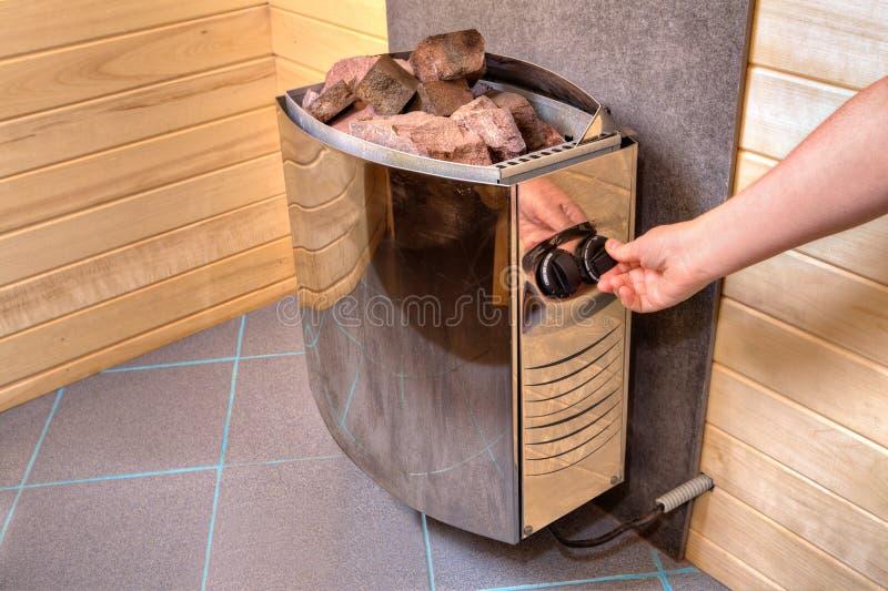 手调控控制板在蒸汽浴的电火炉加热器 免版税图库摄影
