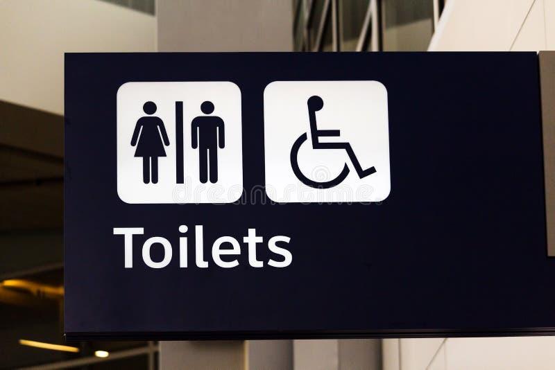 洗手间标志在达拉斯沃思堡国际机场 库存照片