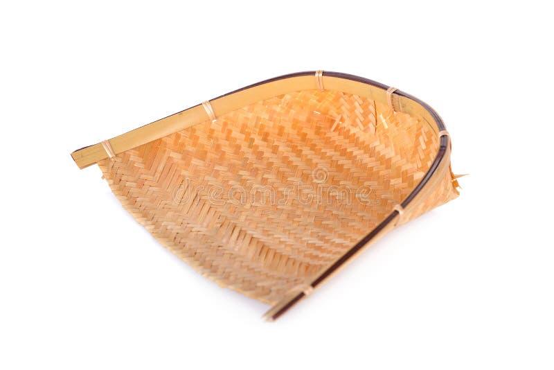 手织的在白色backg的存贮篮子手工制造竹簸箕 免版税库存照片