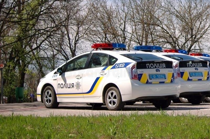 扎波罗热,乌克兰- 2016年4月16日:在立下誓言仪式的乌克兰警车由新的巡逻波尔布特的成员 库存照片