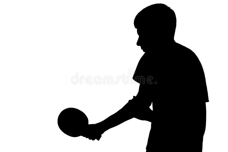 打乒乓球比赛的一个人的剪影 库存照片