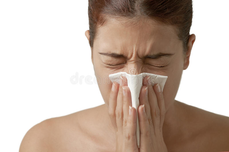 打喷嚏流感的女孩 库存图片